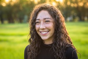 young woman smiling in the park in Houston, TX | Counseling for anxiety | anxiety therapy | Therapist in Houston, TX | 77006