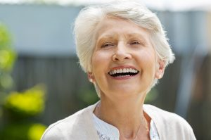 Happy senior woman smiling | Therapy for retirement and other life transitions | Counseling in Houston, TX 77006