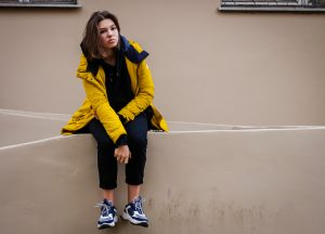 anxious teen girl in a yellow jacket in downtown Houston, TX | Therapy for anxiety | Anxiety treatment | Counseling for Anxiety | Therapist Natalie Mica | 77006