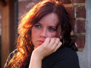 anxious young woman with red hair | Therapy for stress and anxiety | Anxiety therapy | Counseling for anxiety| 77006