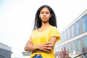 Young african american woman wearing a yellow t shirt looking confident after therapy for depression | depression counseling | Natalie Mica LPC | 77006