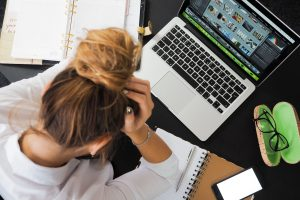 Stressed woman doing too much work. This represents how women are expected to do it all and be it all for everyone and end up feeling stressed or suffer burnout. Therapy can help with stress management. I am a counselor in Houston, TX 77006.