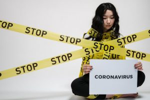 Young adult woman with Coronavirus or COVID-19 practicing social distancing and needing online therapy in Texas | Anxiety & Depression Counseling | Houston, TX Therapist | Natalie Mica LPC | 77006